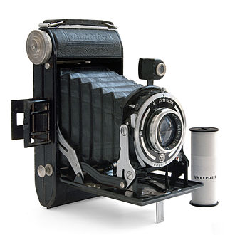 Medium format - Baldafix folding camera, one of a large number of old folding cameras which used medium-format film, with a roll of 120 film