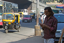 Bangalore guy on phone and autorickshaw November 2011 -40.jpg