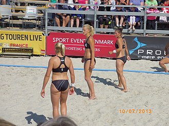 Beach handball - Danish women's team members spread out to cover the court
