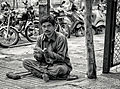 Begging (Outside the Temple) (15467770199).jpg