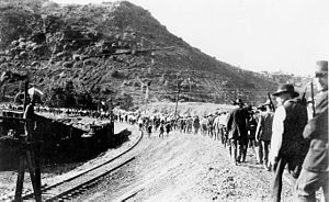 El Paso and Southwestern Railroad - Deportation of striking miners from Bisbee, Arizona, on July 12, 1917. Striking miners and others are marched from Warren Ballpark along railroad tracks toward cattle cars belonging to the El Paso and Southwestern Railroad.