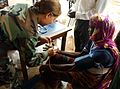 Blood pressure test on a Ghanaian woman - Medflag 2006 - Defense.gov 060912-F-0919E-135.jpg