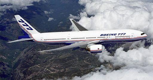 Boeing 777 above clouds, crop