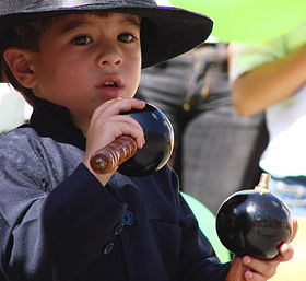 Boy playing maracas Forum Monterrey.jpg