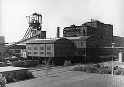 """1900s typical mining structure in the Ruhr, source of the Schalke nickname Die Knappen – from an old German word for """"miners""""– because the team drew so many of its players and supporters from the coalmine workers of Gelsenkirchen"""