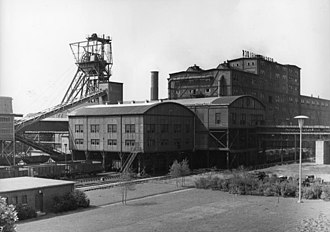 "FC Schalke 04 - 1900s typical mining structure in the Ruhr, source of the Schalke nickname Die Knappen – from an old German word for ""miners""– because the team drew so many of its players and supporters from the coalmine workers of Gelsenkirchen."