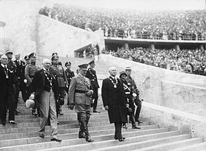 Olympische Hymne - Opening ceremony of the 1936 Summer Olympics: Adolf Hitler, Henri de Baillet-Latour and Theodor Lewald enter the Olympic Stadium, Berlin