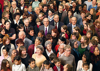 Swiss people - Members of the Federal Council standing among the people in the crowded Federal Palace for the 2008 official photo