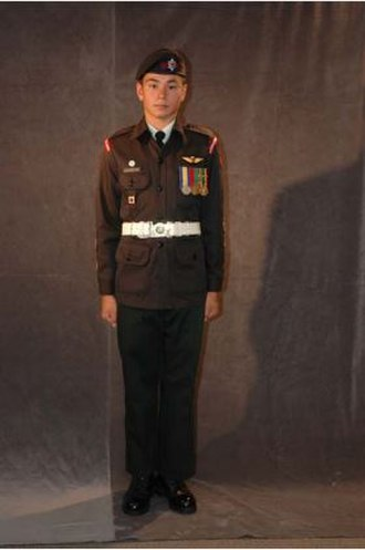 Royal Canadian Army Cadets - An Army Cadet wearing the C1 order of dress (Ceremonial Dress) before significant changes were made to the placement of medals.
