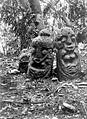 COLLECTIE TROPENMUSEUM Twee stenen beschermbeelden op een open plek in het bos TMnr 10000892.jpg