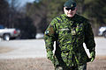 Canadian Army Maj. Douglas Grant, 37th Canadian Brigade Group, checks on training at Fort Pickett, Va., March 4, 2013, during Exercise Southern Raider 13 130304-A-KH856-095.jpg