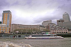 A Thames Clipper catamaran calls at Canary Wharf Pier