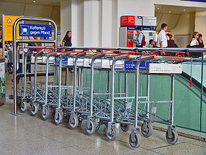Baggage cart - Baggage carts available for a deposit at a German train station