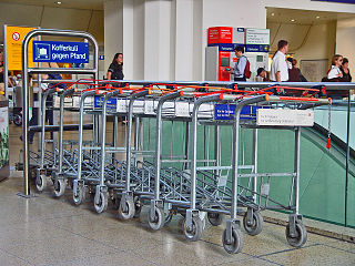 small vehicles pushed by travelers to carry individual luggage