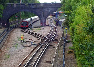 Newbury Park tube station - Looking south from the bridge above King George Avenue, with a Central line train parked at the siding.