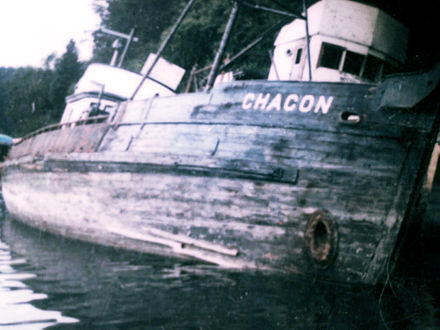 Chacon resting on beach before salvage. Another unknown boat behind her.