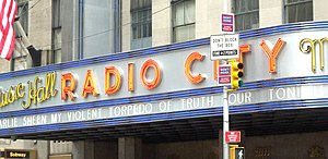 "Charlie Sheen - Sheen's ""My Violent Torpedo of Truth/Defeat is Not An Option"" tour on the marquee of Radio City Music Hall in New York City."