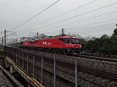 Two China Railway HXD3Ds hauling a long-distance passenger train. China Railways HXD3D 0250 & HXD3D 0496 20180511 01.jpg