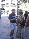 Clinton Supporters Look To Persuade, Hand Out Buttons (2803564197).jpg