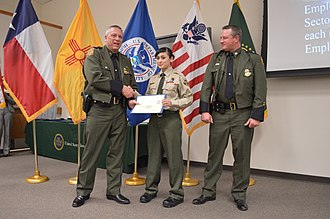 Law Enforcement Exploring - U.S. Customs and Border Protection Deputy Division Chief Michael E. Przybyl presented Border Patrol Explorer Kaila Paul of Deming, N.M., with the CBP sector level award.