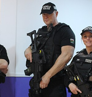 Authorised firearms officer - North Wales Police Authorised Firearms Officers with Heckler & Koch G36C rifle during UK general election in June 2017