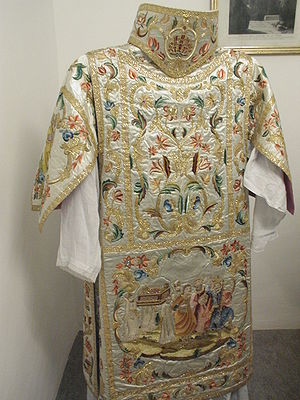 Deacon - Ornately embroidered dalmatic, the proper vestment of the deacon (shown from the back with an appareled amice)