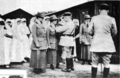 Dr. Caroline Sandford Finley & Dr. Anna Von Sholly receiving the Croix de Guerre (1918).png