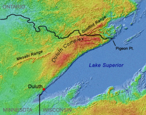 Duluth Complex - Shaded-relief image showing the Duluth Complex arcing from Duluth to Pigeon Point, interrupting and splitting the Mesabi and Gunflint Ranges