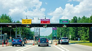 E-ZPass - A New Hampshire E-ZPass plaza also using a coin drop basket (left) and a conventional toll booth (right)