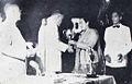 Elly Joenara giving an award to Pallner Siegartz Dunia Film 15 Jul 1954 p17.jpg