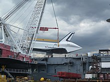 Weeks 533 lifts Enterprise onto Intrepid