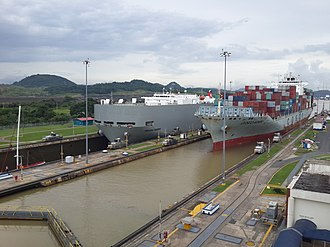 Offshore financial centre - Commercial ships register in Central American states to avoid scrutiny from foreign countries. Pictured: a large carrier ship docking in Panama.