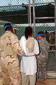 Escorting a Guantanamo captive to a recreational area -- Sept. 30, 2007.jpg