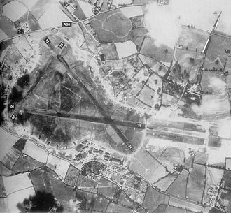 Class A airfield - An aerial view of RAF Exeter airfield on 20 May 1944, showing the triangular layout of the runways and the encircling (light-coloured) perimeter track