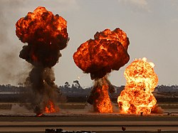Gasoline explosions, simulating bomb drops at an airshow
