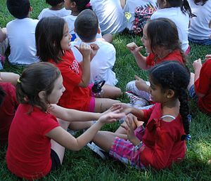 Clapping game - Children in Virginia playing hand games at school.