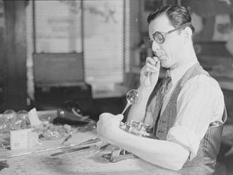 Glassblowing - Glassblower Romeo Lefebvre in his workshop in Montreal, 1942