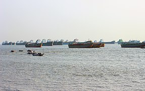Fishing trawlers and Harbor ships are waiting far from the Patenga sea beach for port of Chittagong.jpg