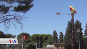Foreign relations of Rojava - Flags of Rojava and Turkey at a border crossing in northern Syria