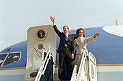 Former President and First Lady Carter wave from their aircraft