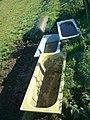 Four bathtubs on a pasture.jpg