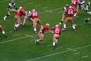 Frank Gore (21) of the San Francisco 49ers tak...