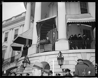 Truman Balcony - This photograph, taken at Franklin D. Roosevelt's fourth Inaugural Address, shows the White House's south face before the Truman Balcony was built. The awnings that Truman disliked are visible.