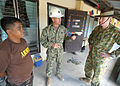 From left, Philippine Army Capt. Felipe Estrada; U.S. Navy Lt. Cmdr. Joe Harder, the operations officer for the Joint Civil Military Operations Task Force; and Australian Army Lt. Col. Mike Scott discuss 130406-N-VN372-080.jpg