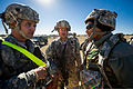 From left, U.S. Army human resource specialists greet Air Force Lt. Col. Angela Thompson, a health services administrator with the 18th Aeromedical Evacuation Squadron, upon arrival at Geronimo Landing Zone 140116-F-XL333-096.jpg