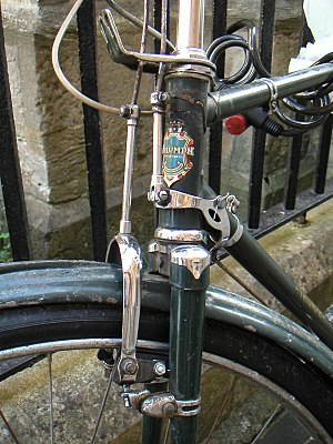 Bicycle brake - Rod brake system. Lateral play in the pivot for the rear brake rod allows for rotation of the handlebar