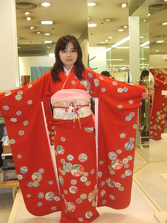 Furisode - Girl holding up the furisode sleeves of her kimono