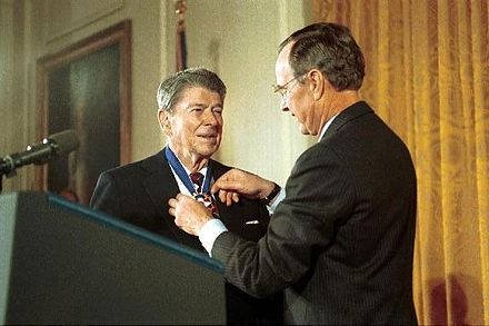 Former President Reagan returns to the White House to receive the Presidential Medal of Freedom from President Bush, 1993 GHW Bush presents Reagan Presidential Medal of Freedom 1993.jpg