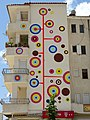 Gaily-Painted Apartment Block - Delvina - Albania (40539072730).jpg