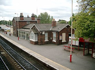 Garforth railway station - The station buildings and platform 2 (Leeds bound) seen from the footbridge.